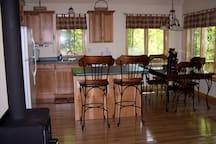 GREAT ROOM - Big Wilson Camp has a large great room with a wood stove, cathedral ceilings and  comfy north woods decor.
