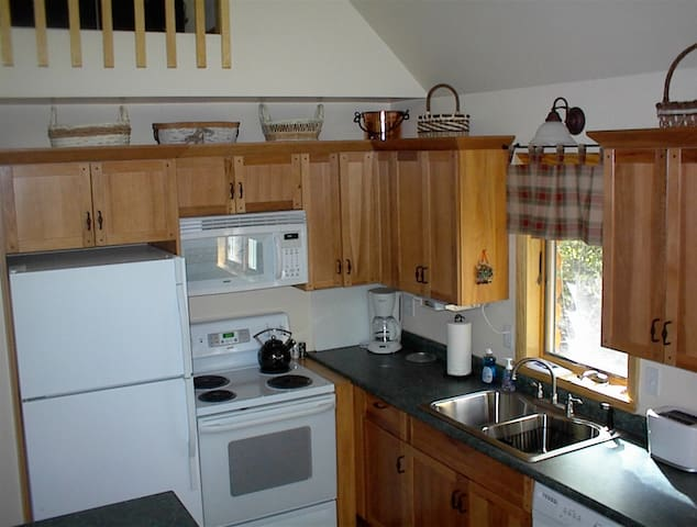 FULLY EQUIPPED KITCHEN - Compact, but with all the comforts of home.
