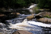 LITTLE WILSON LOWER FALLS and swimming hole, a 10-minute hike from camp.
