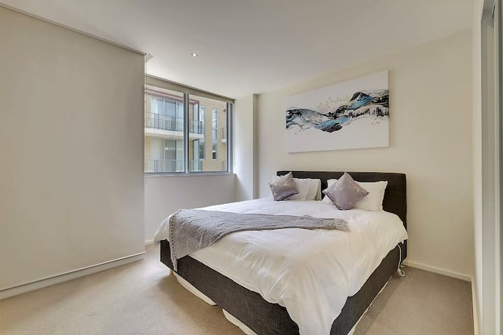 Large Master Bedroom with comfortable quality mattress including two built-in wardrobes