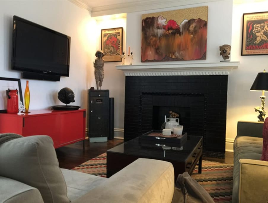 Decorative fireplace in the living room adds a ton of charm