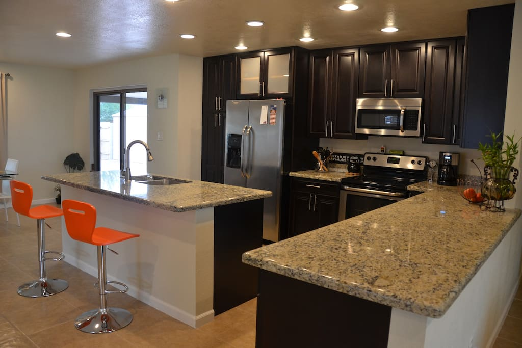 Contemporary fully equipped kitchen.  Keurig coffee maker.