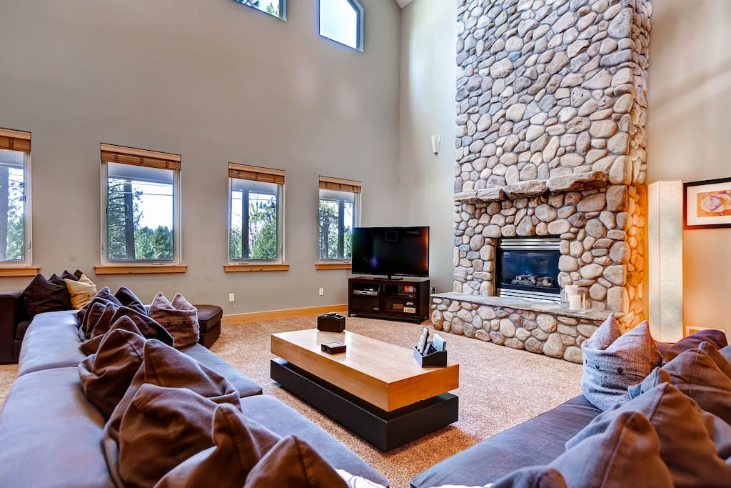 Living room with large HDTV and beautiful stone gas fireplace