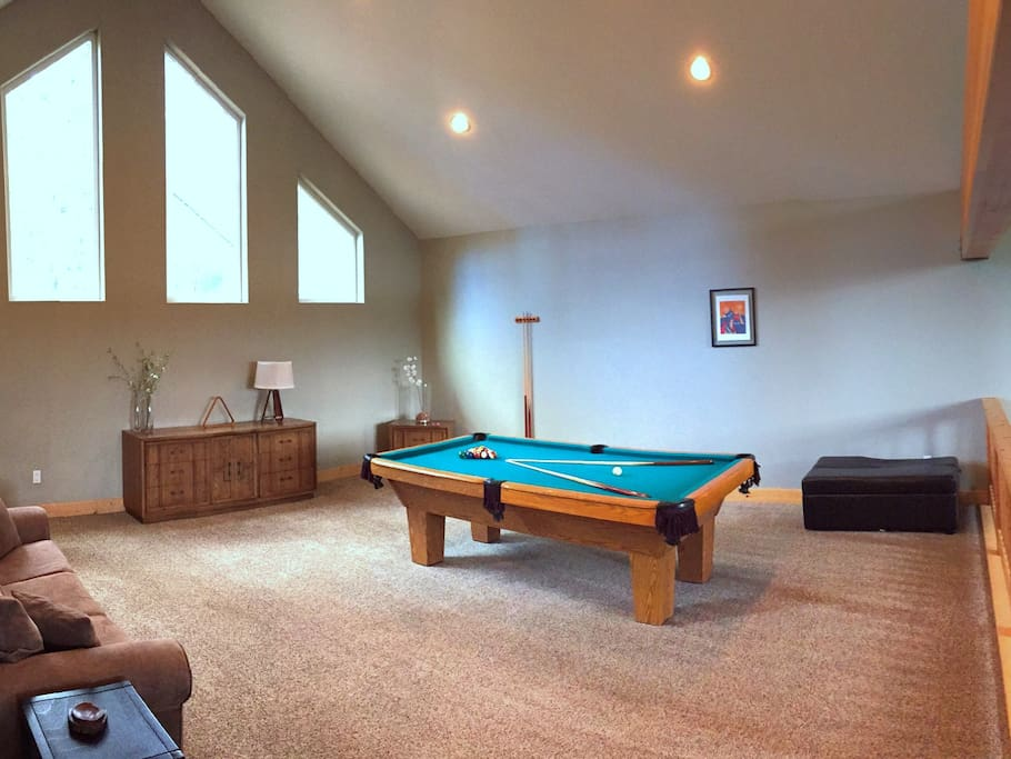 Huge loft with regulation pool table, HDTV for DVDs and games, plus sofa sleeper