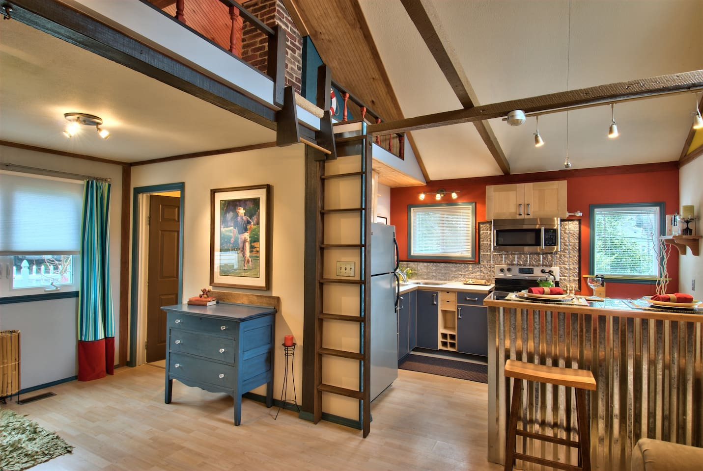 Entry at Left; viewing Kitchen from Living Room and peak of Loft