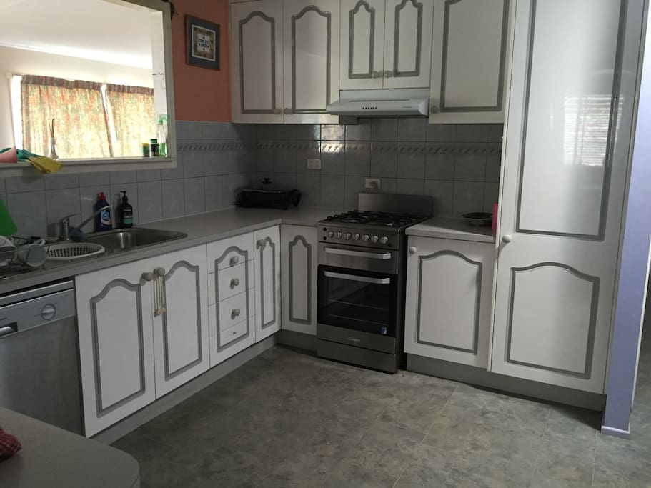 Fully supplied kitchen with new gas stove, dishwasher, microwave and all the necessities to cook just about any meal.