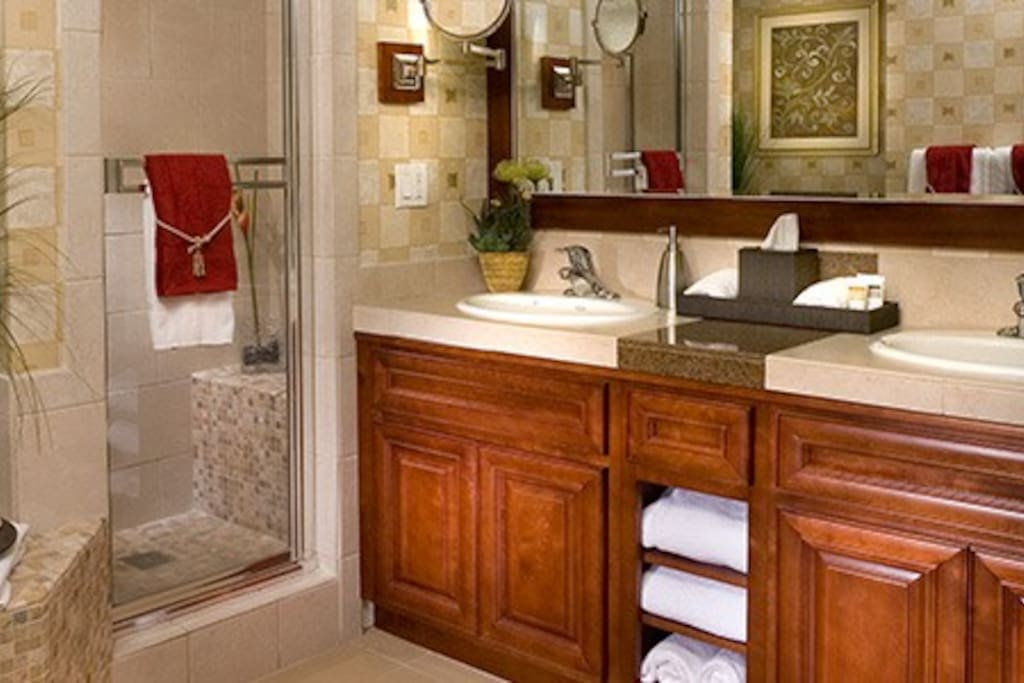 Master bath with separate double- headed shower and garden tub