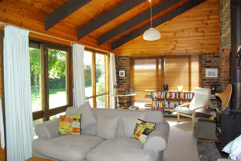 One of two sun-filled living rooms