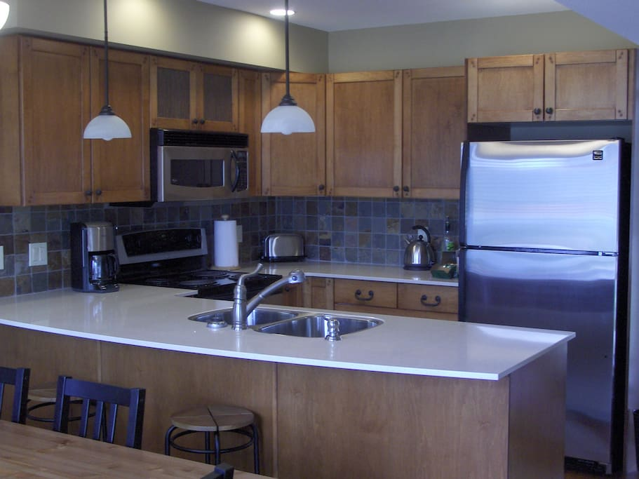 Maple cabinets, quartz countertops and stainless steel appliances for a luxurious stay.