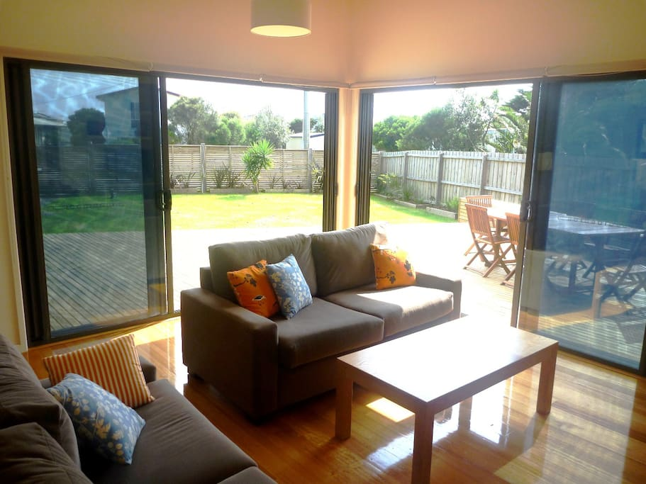 The living space opening onto the deck