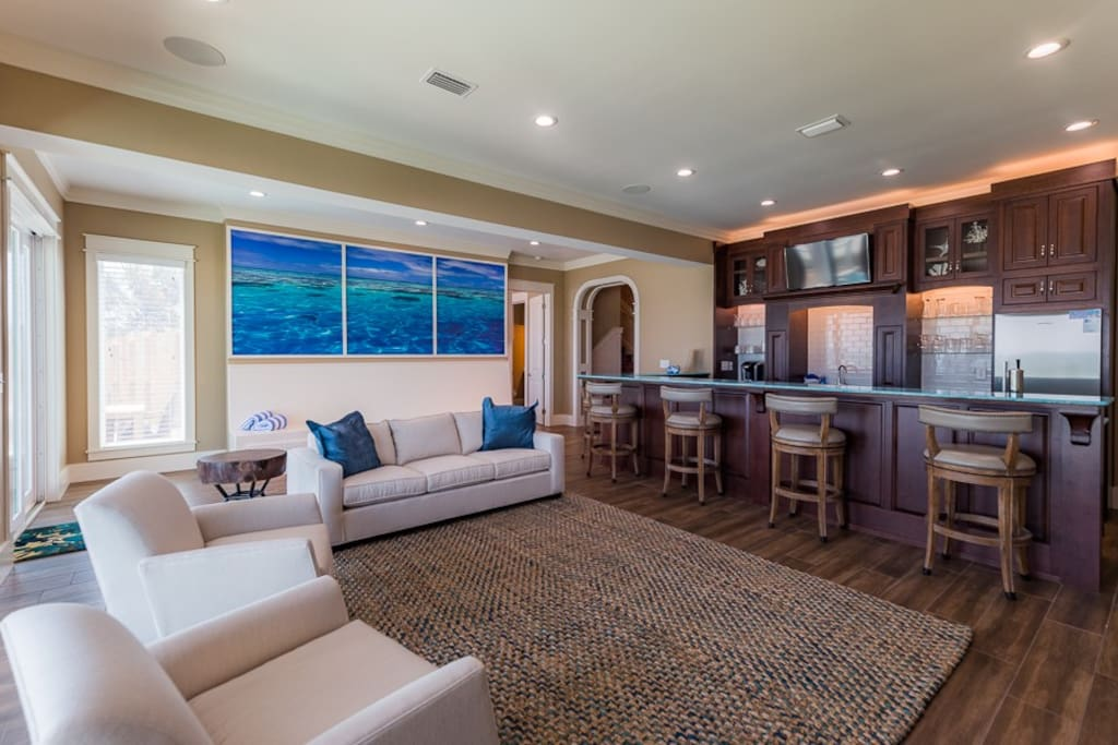 Ground level living area complete with wet bar and multiple TVs