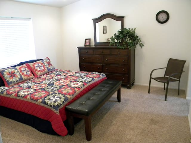 Master Bedroom - king bed, dressers and nightstands, private bath, closets