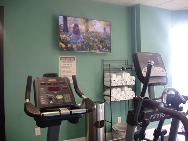 Watch TV while you workout in the fitness room. Treadmill, elyptical, weight machine.