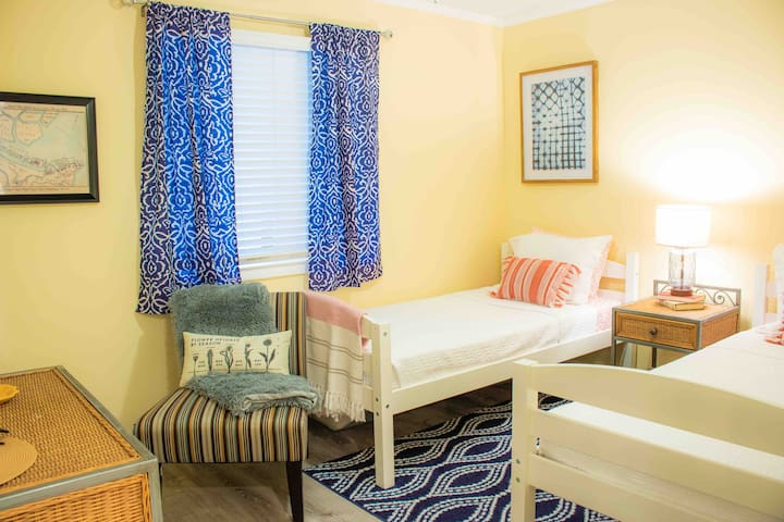 The guest room has two twin beds.