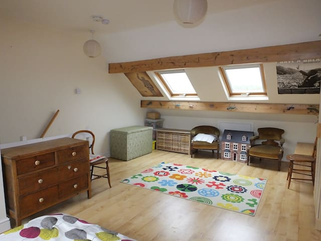 Large sunny attic room in terraced house