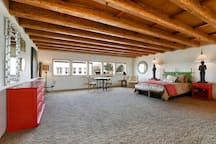 The large spacious loft has a queen bed