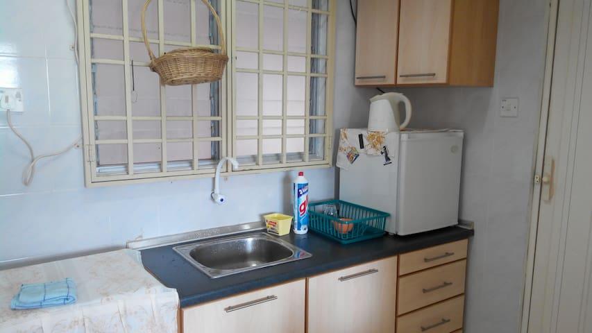 Kitchen with mini fridge