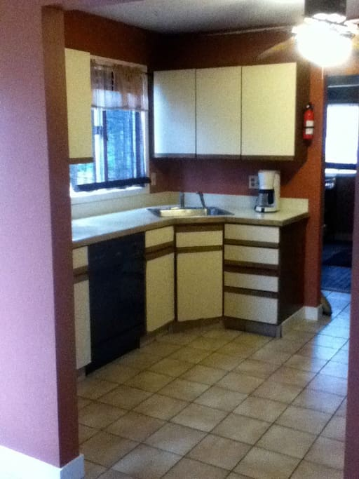 We know....we know....80's kitchen...works great!!  New stove and refrigerator on the premises!