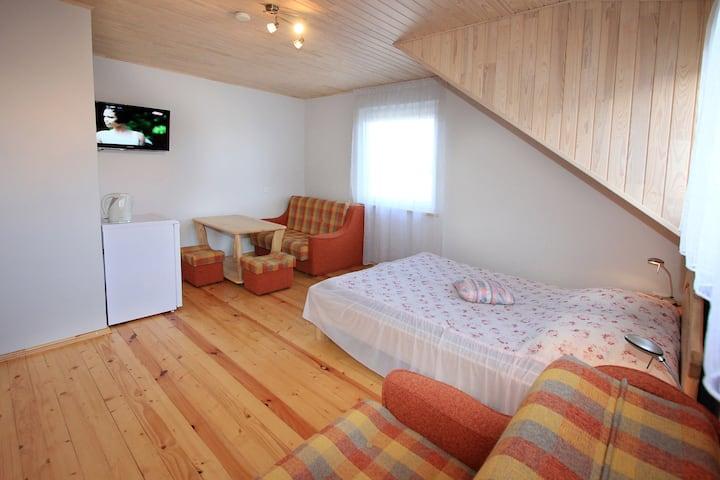 Comfortable quadruple in top floor