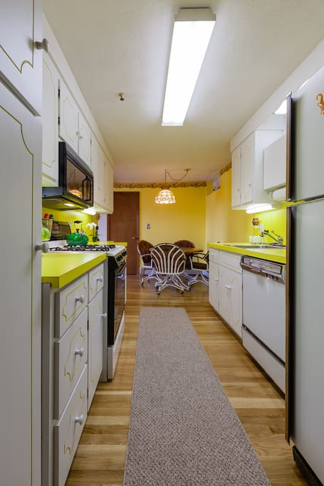 Fully equipped kitchen with full-size refrigerator.