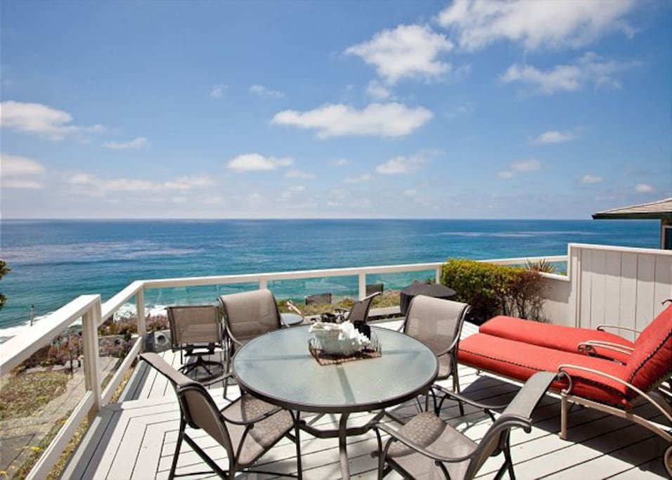 Oceanfront Deck With Grill and Patio Furniture.