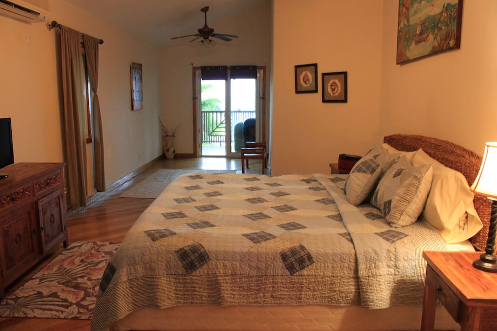 Spacious master bedroom with access to the deck.
