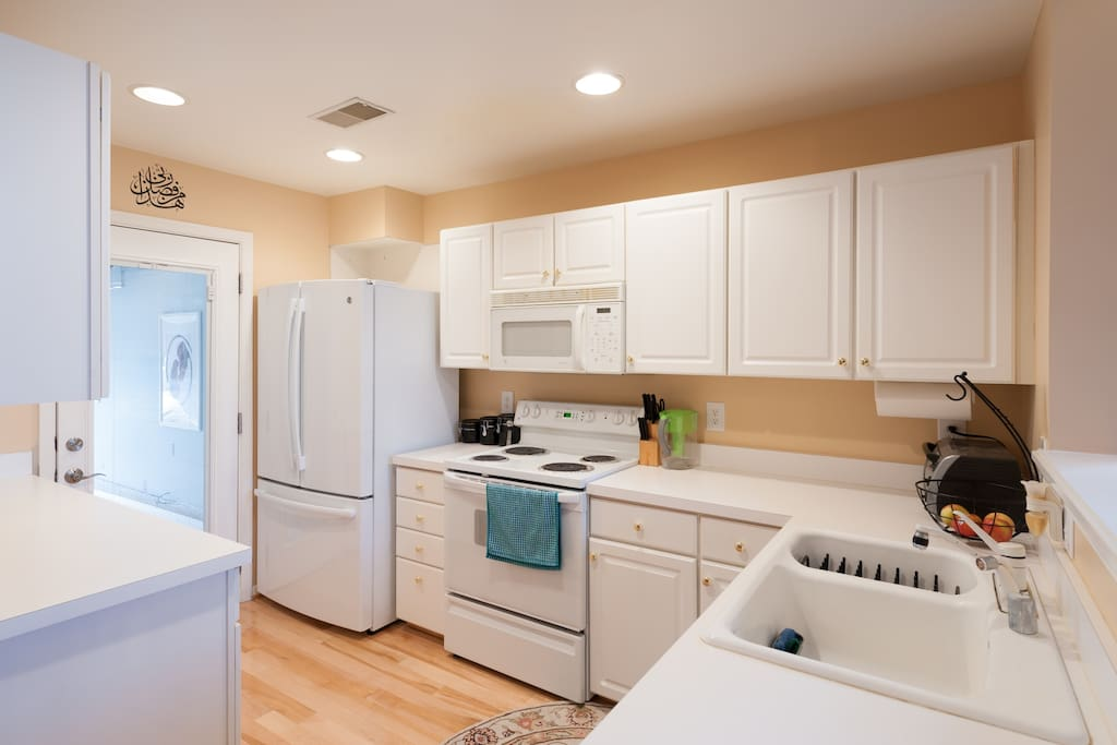 Full kitchen with electric stove, oven, microwave, dishwasher, and custom fridge (stocked with eggs, butter, milk)