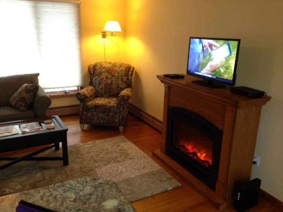 Cozy electric fireplace.  Cable TV and wireless Internet access.