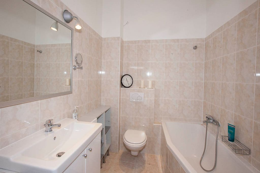 Clean and bright bathroom with shower (shared with me). I´ll provide you with towels, shower gel and shampoo.