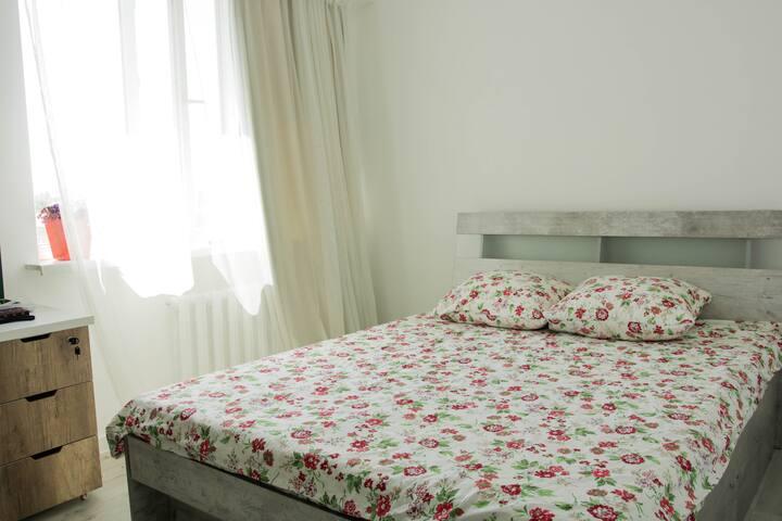 Comfortable double bed in bedroom