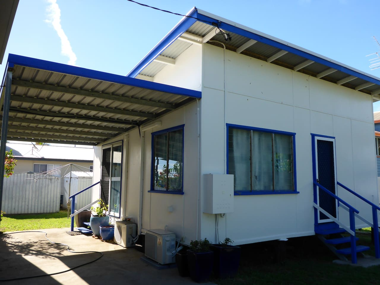 Carport and entry doors to Kitches Cabin - 2 bedrm, kitchen, bath/shr, 3 x split aircond. Free wifi internet