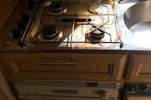 Gas hobs, grill and oven. Ideal for making a cuppa in the morning.