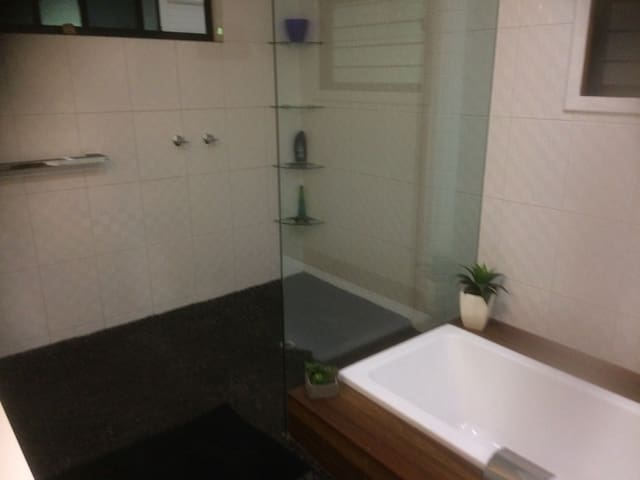 Bathroom with bath and separate shower.