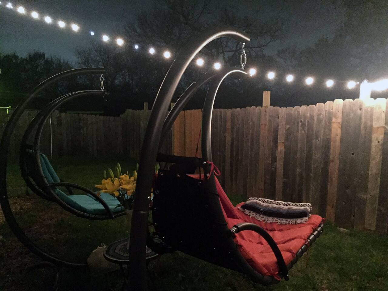 Back yard with hanging lounge chairs