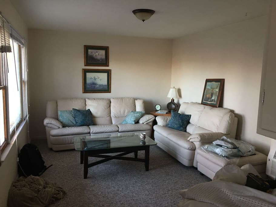 Living room area. Recliner couch. Tv has a DVD player and there is also 100 plus movies to pick from if interested. 32 inch flat screen tv.