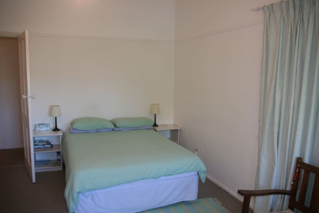 Roomy main bedroom with ample cupboard space