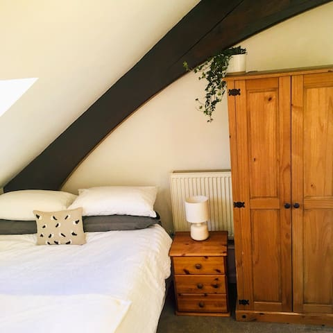 Cosy double bedroom in a converted church building