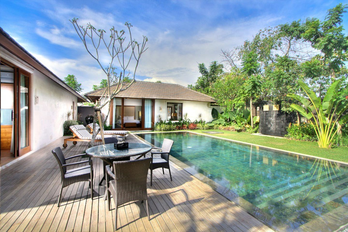 swimming pool with beautiful tropical garden