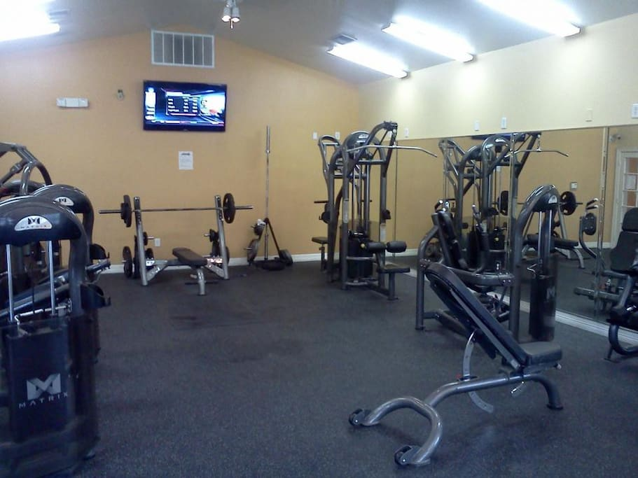 Fitness center with weights & connecting game center