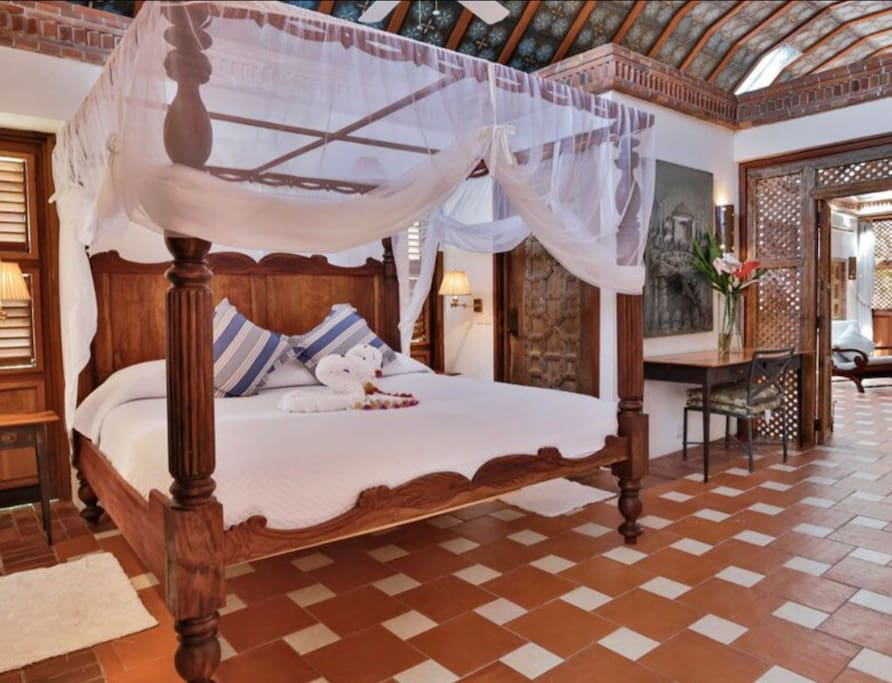 Handmade four poster bed in Temple Suite
