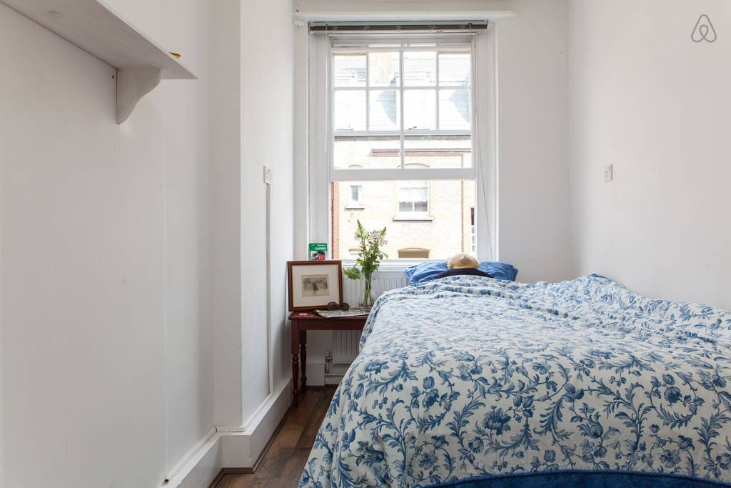 Your bedroom! Nice comfy double bed with a big sash window and a big wardrobe on the other side.