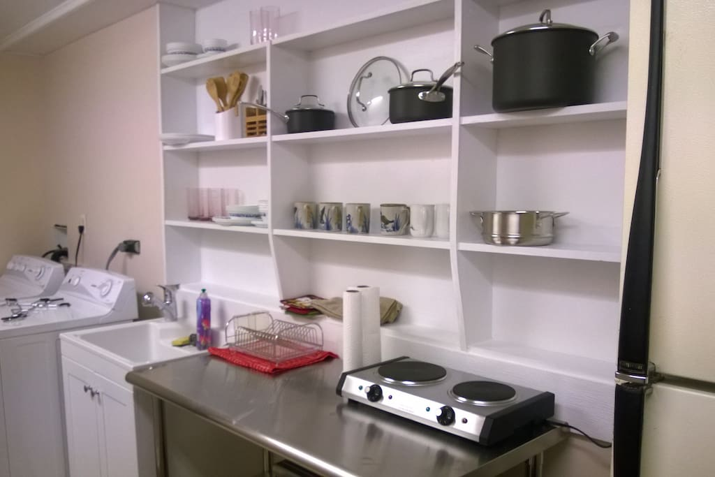 Kitchenette for cooking flexibility, including full use of laundry facilities and detergent