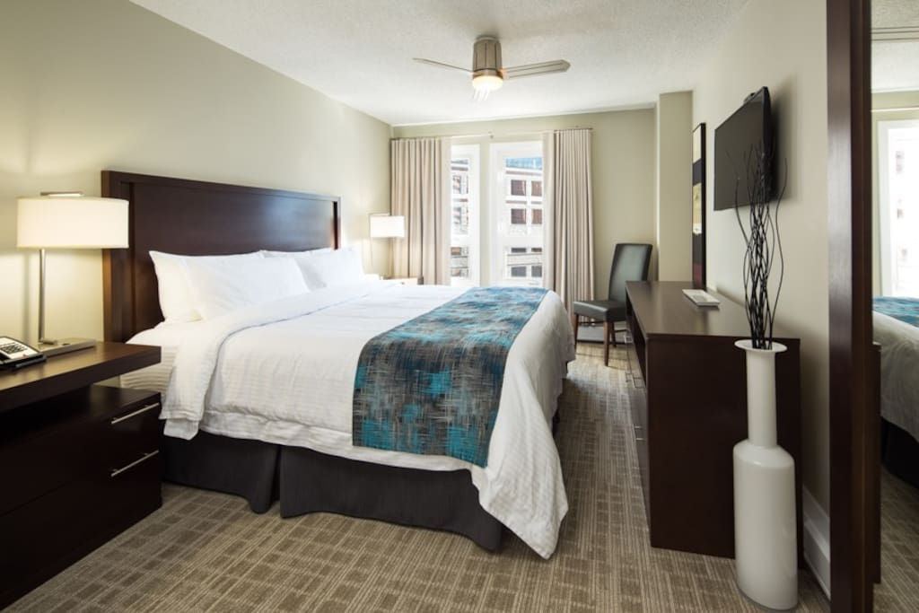 Bedroom with King size bed with quality bedding and linens