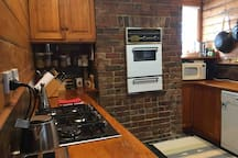 Our quaint kitchen is surprisingly spacious and well equipped, with a new stove, a dishwasher and a microwave. You will enjoy preparing your meals if you choose to stay at home.