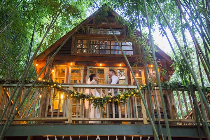 """Tiny treehouse wedding at dusk.  Say """"I do"""" in the bamboo, on the illuminated stage of the treehouse. Shakespeare would be impressed at the visual beauty."""
