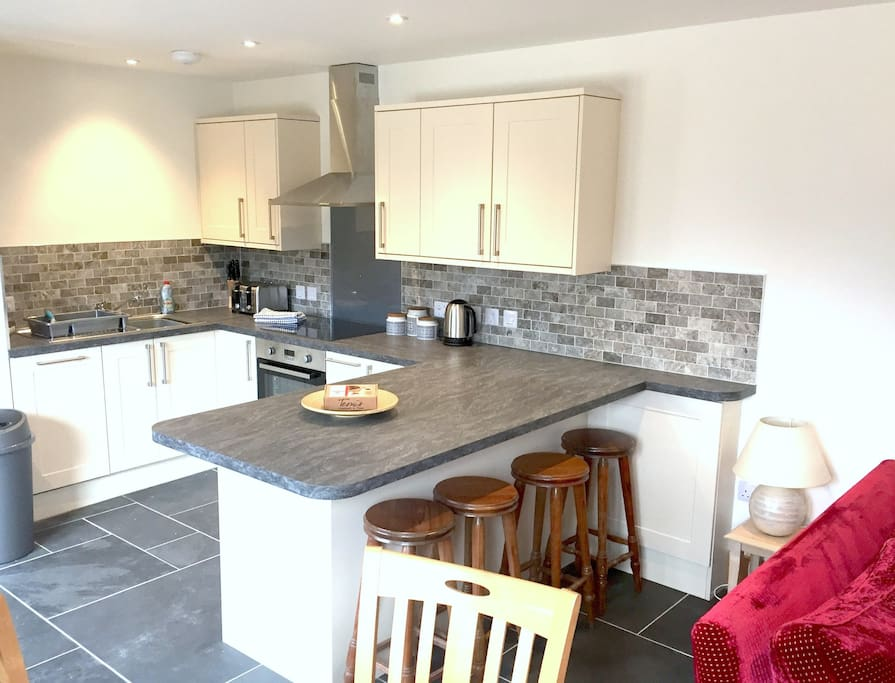 Open plan living - kitchen with everything you could need including dishwasher