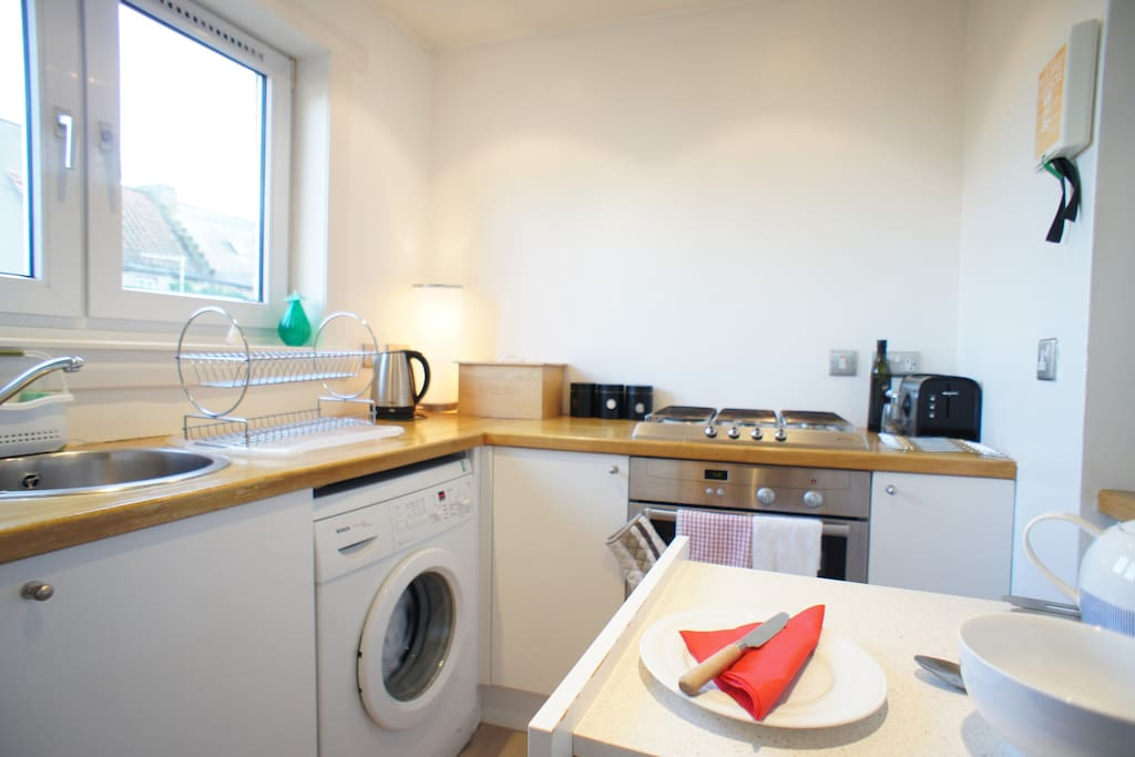 The kitchen is bright and well equipped with fridge/freezer, oven & gas hob, washing machine, microwave, kettle, toaster and cooking utensils which overlooks the beautifully kept communal rear garden