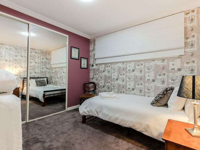 Bedroom 4 with king single bed and additional single floor mattress