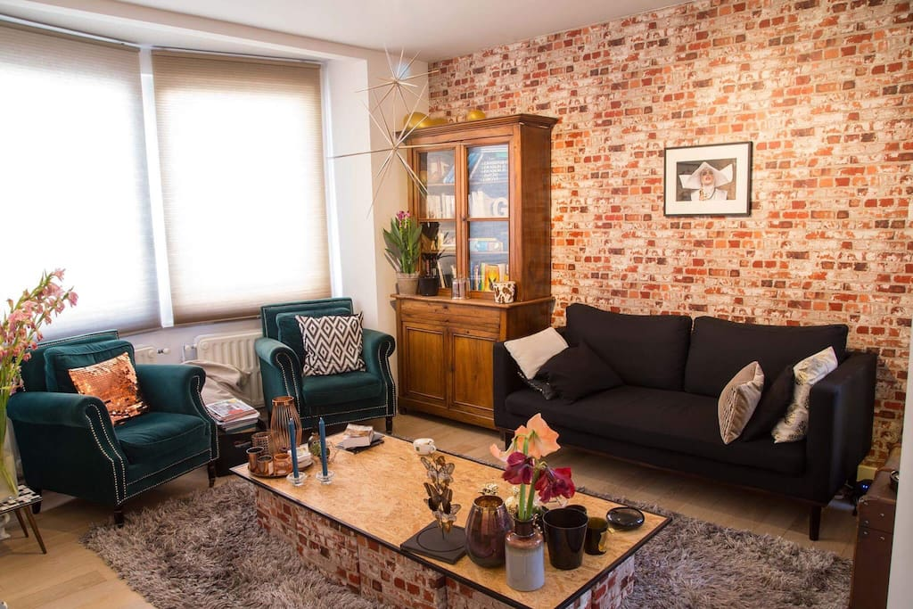 Other view of the living room with our favourite brick wall