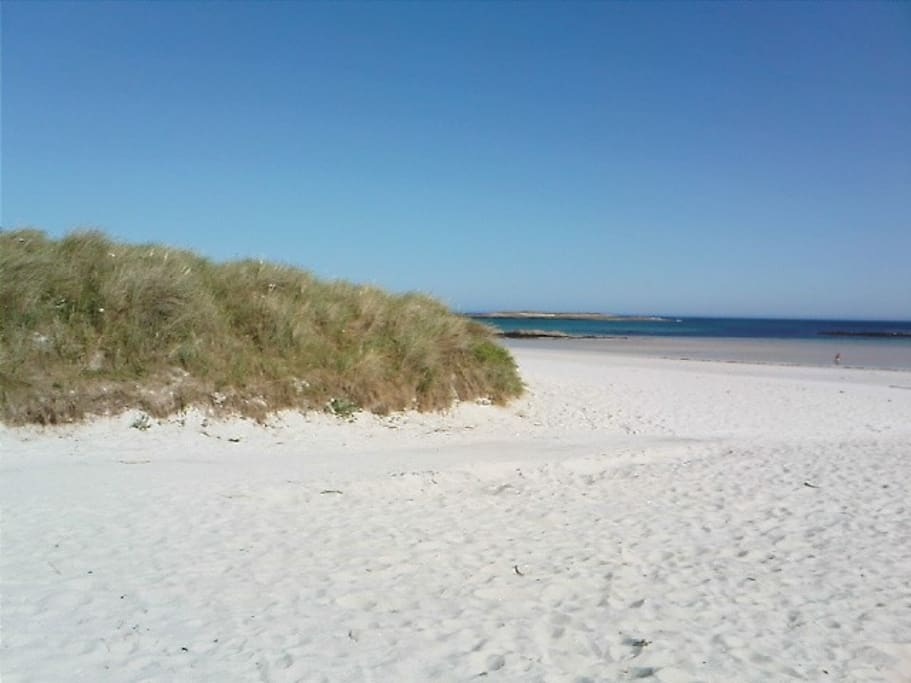 Plage de sable blanc immaculé